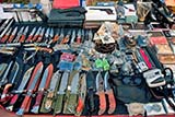 Knives for sale at a Thai Sunday market - Click for larger image