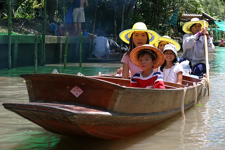 Tourists at Thailand's famous floating market in Damnoen Saduak