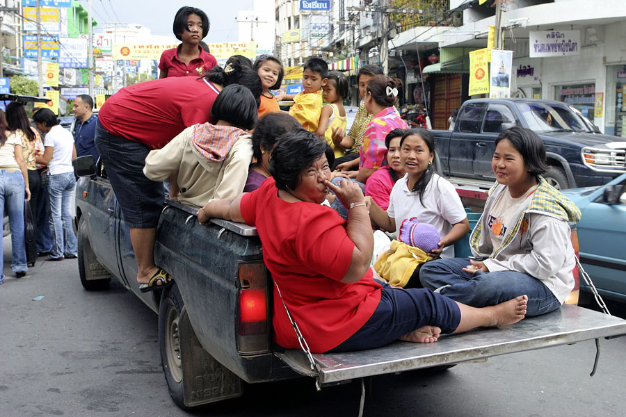 A classy Thai woman in the back of a pickup truck