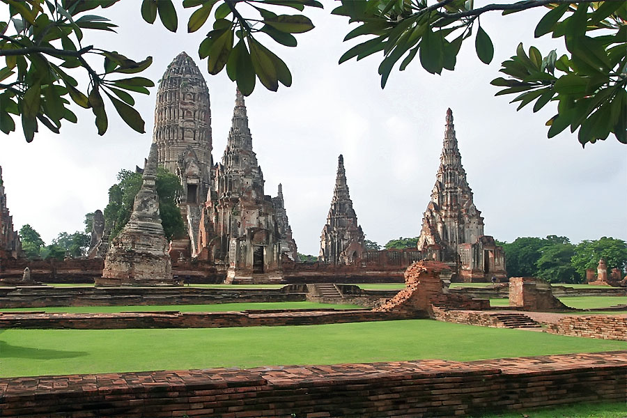 The lush green grass, red brickwork and beautiful architecture of the temples of Ayuthaya