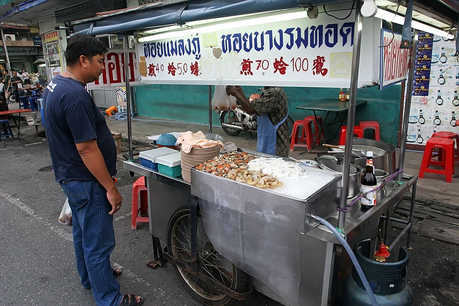 Street vendor selling deep fried shellfish