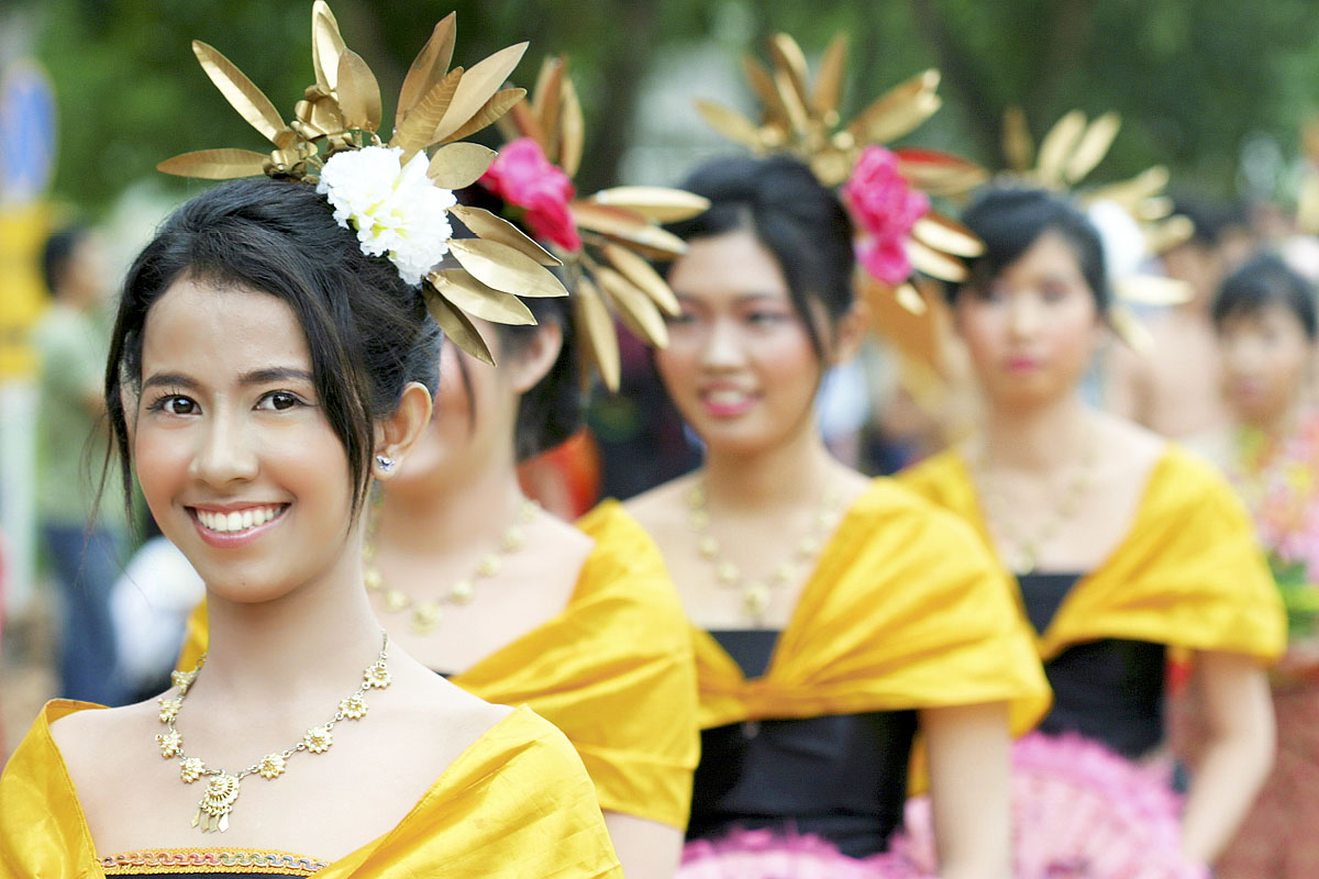 Lovely, smiling Thai girls in a Loy Gratong parade