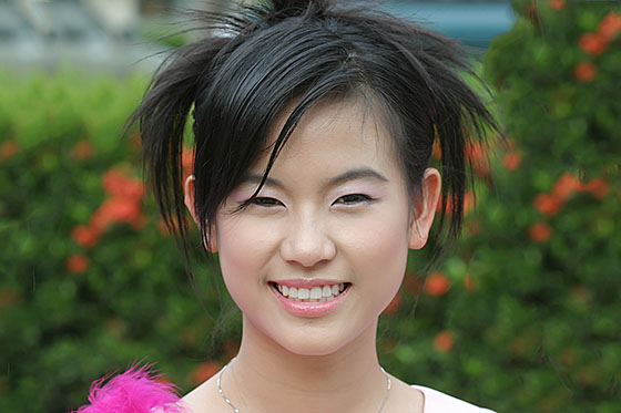Pretty Thai university girl taking part in the Loy Gratong festival
