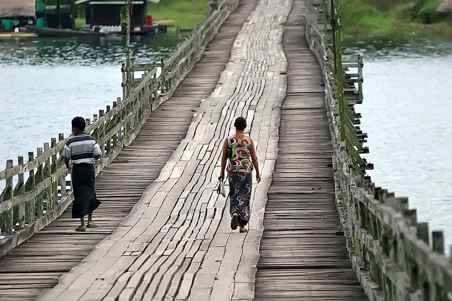 Some locals crossing the Sangkhlaburi wooden footbridge