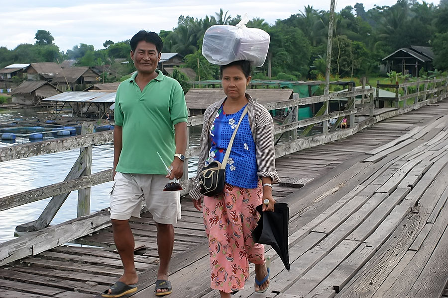 Local Mon people crossing the wooden footbridge in Sangkhlaburi