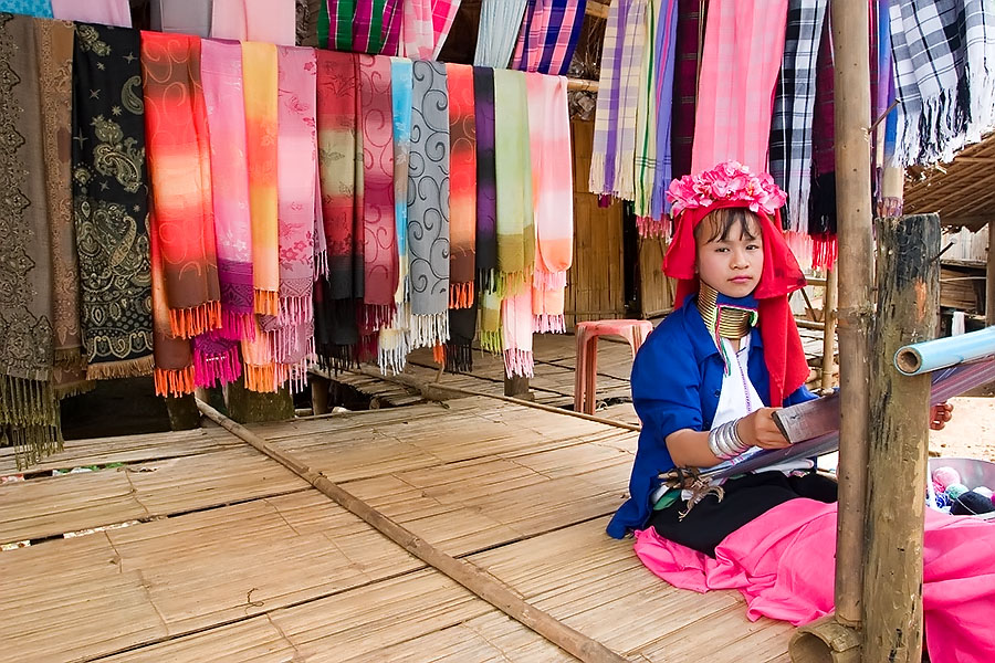 Hilltribe girl weaving cloth, Chiang Rai