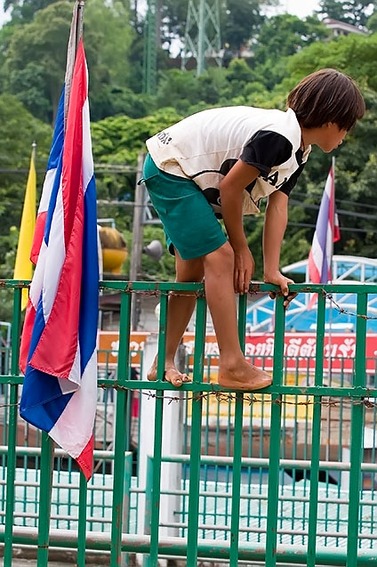 Burmese kid climbing over the border to Thailand at Mae Sai, Chiang Rai