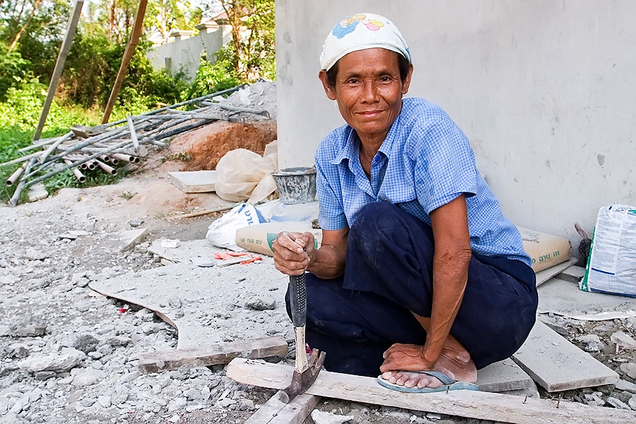 Thai women involved in construction work incredibly hard