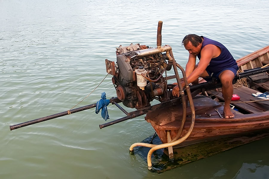 Longtail boat engine maintenance at Patong beach