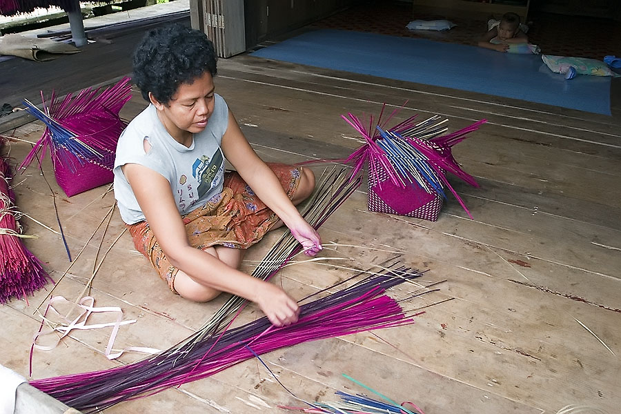 Making bags from dyed reeds harvested from Thale Noi, Phattalung province, Thailand