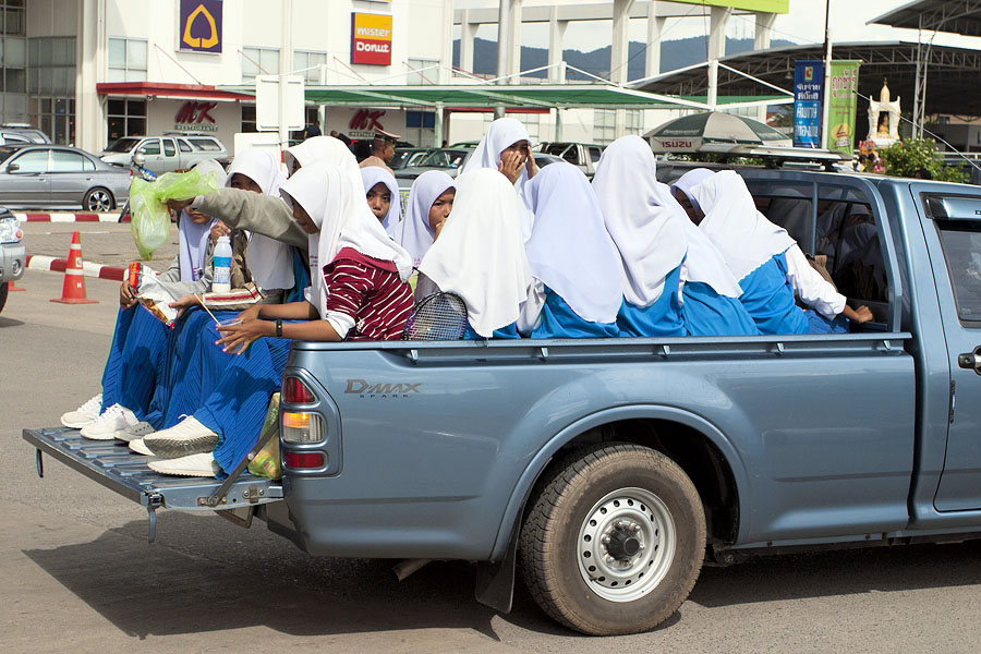 Travelling in the back of pickup trucks is very popular with Thai Muslims