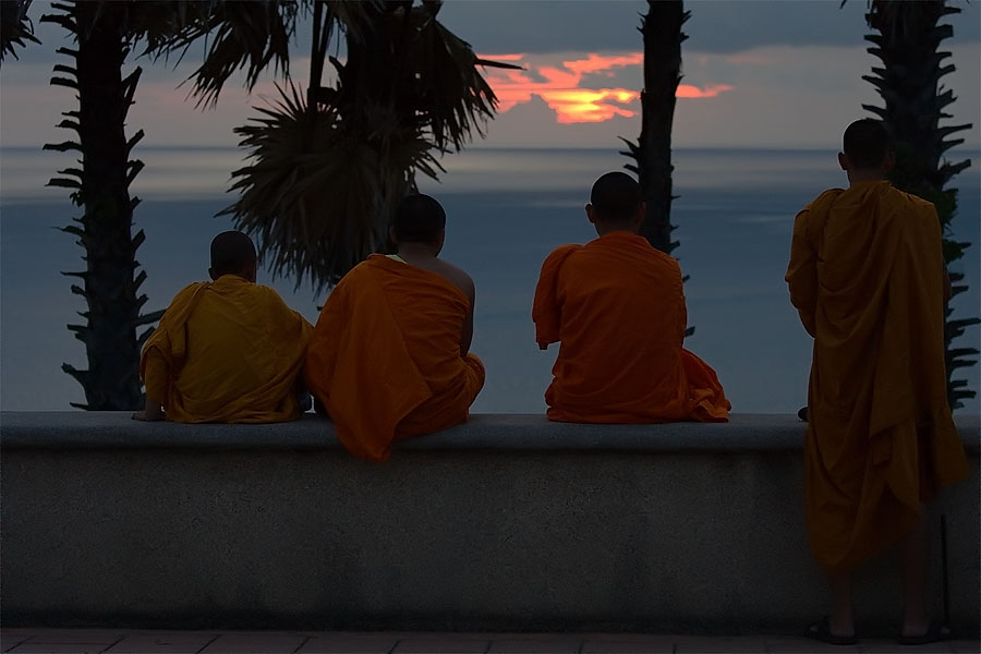 Monks watching the sunset in Phuket