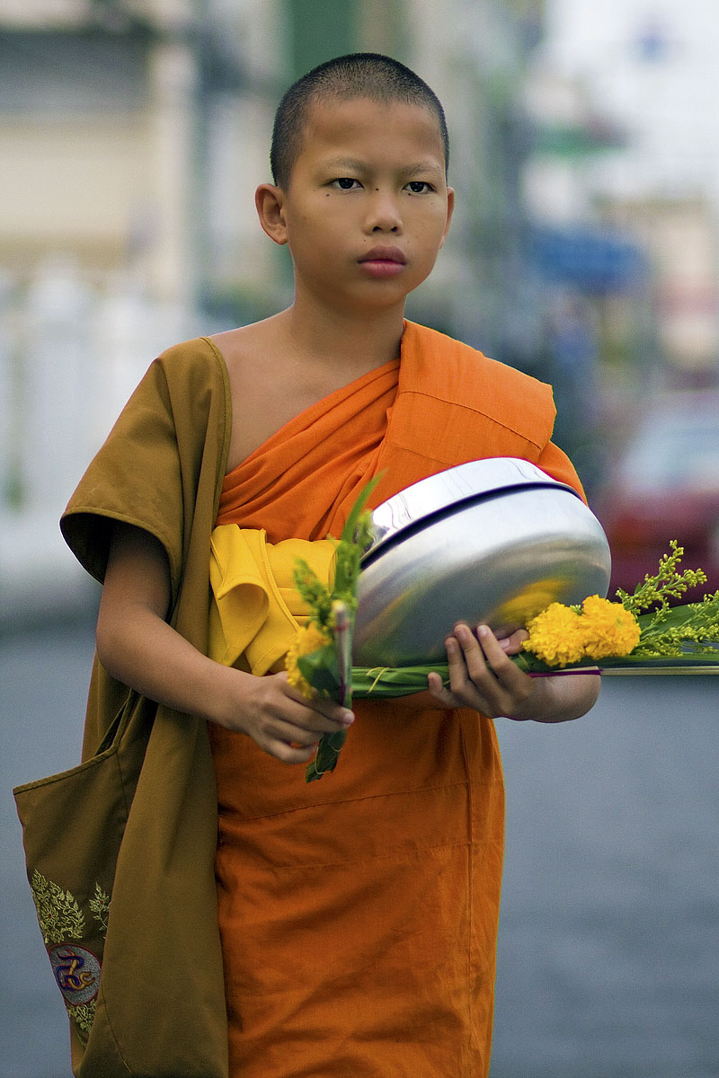 Novice monk collecting alms