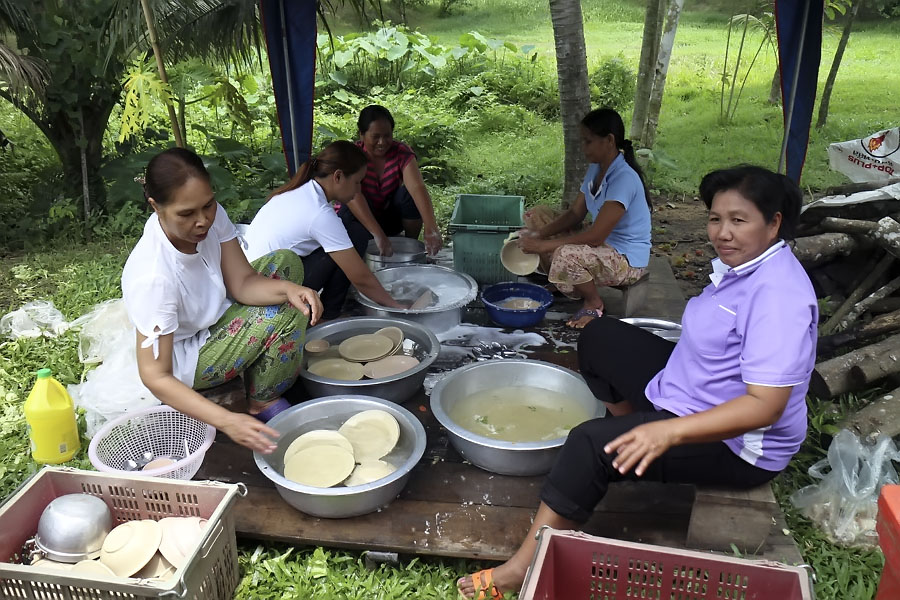 The women prepare food and wash dishes