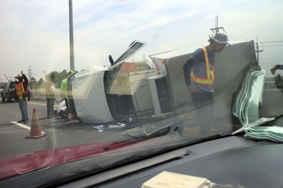 Pickup truck on its side on the Bangkok to Pattaya motorway