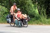 Fuzzy photo of foreigners cycling in Thailand - Click for larger image